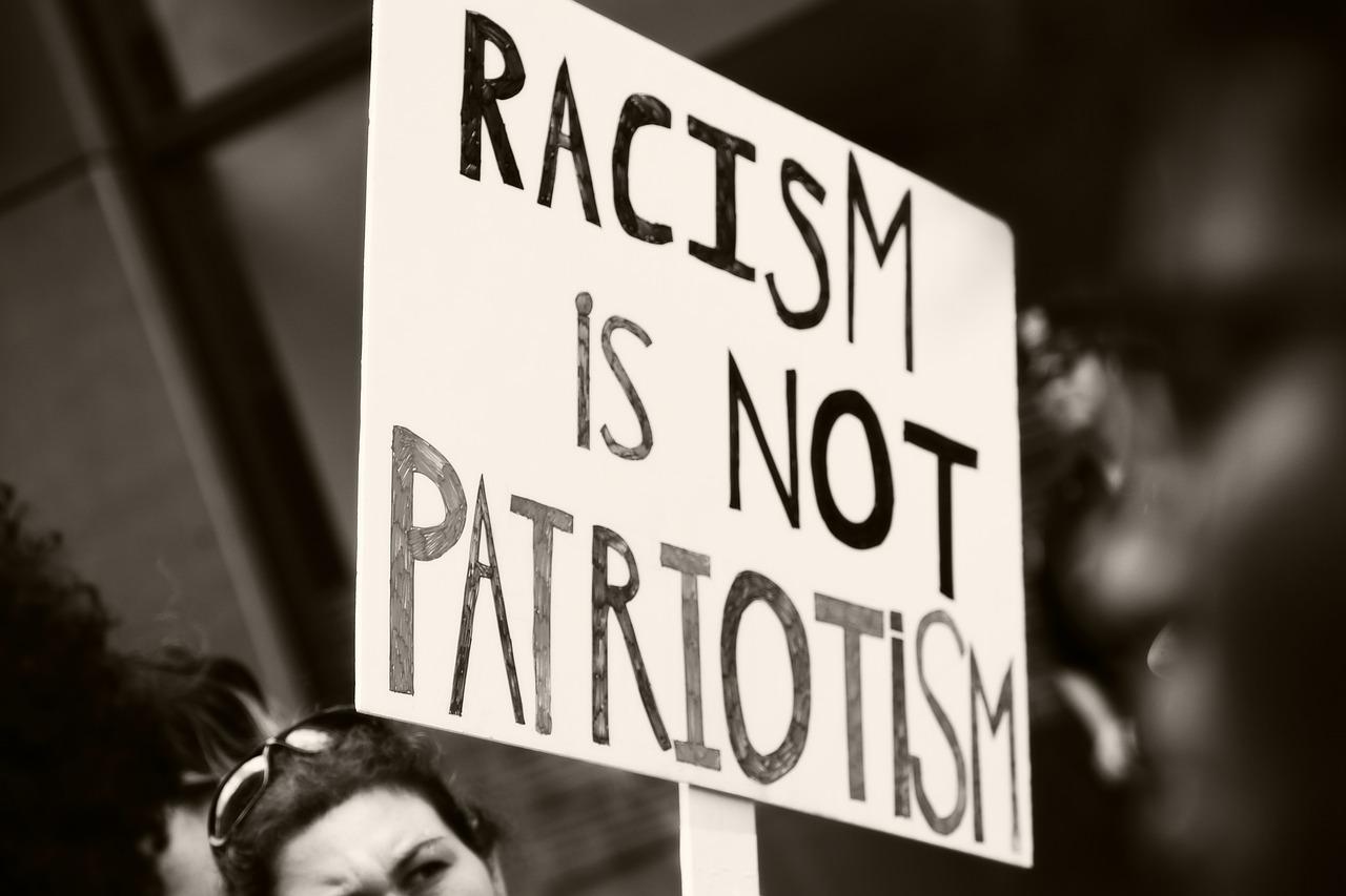 Racism is not patriotism sign.